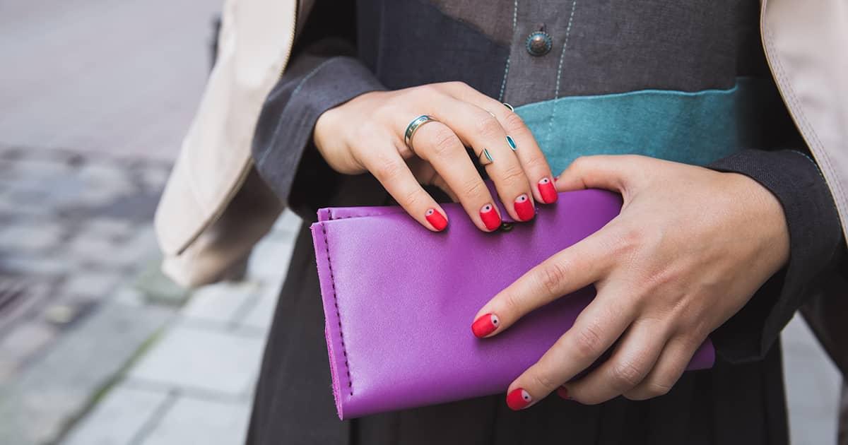 a woman holding a purple purse