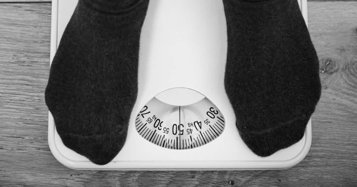 a man on a weighing scale
