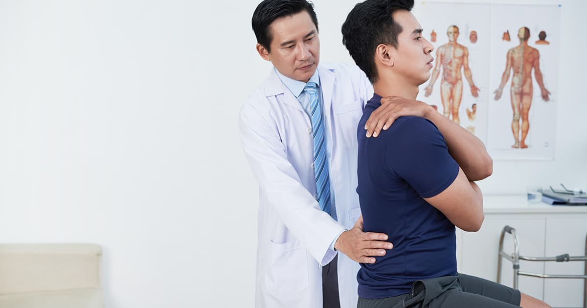 doctor checking his patient
