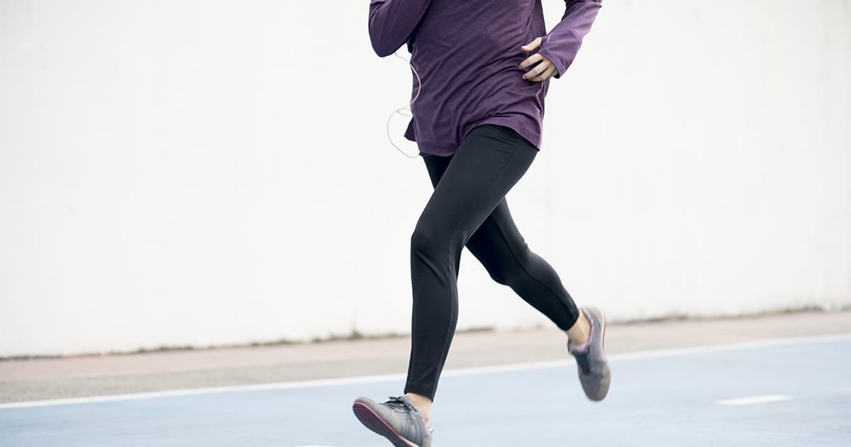 a woman jogging on a track