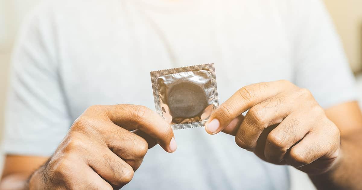 a man holding a condom