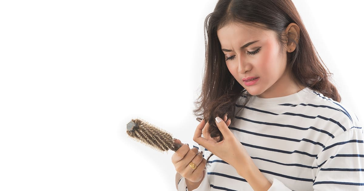 a woman checking her comb and mirror