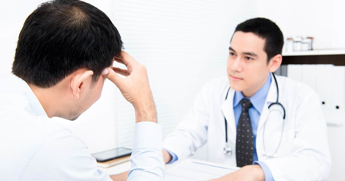 man asking a doctor about hair loss