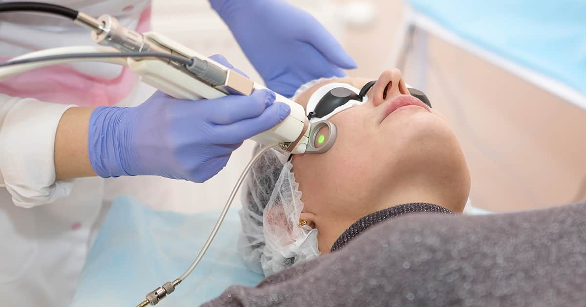a woman receiving medical laser treatment