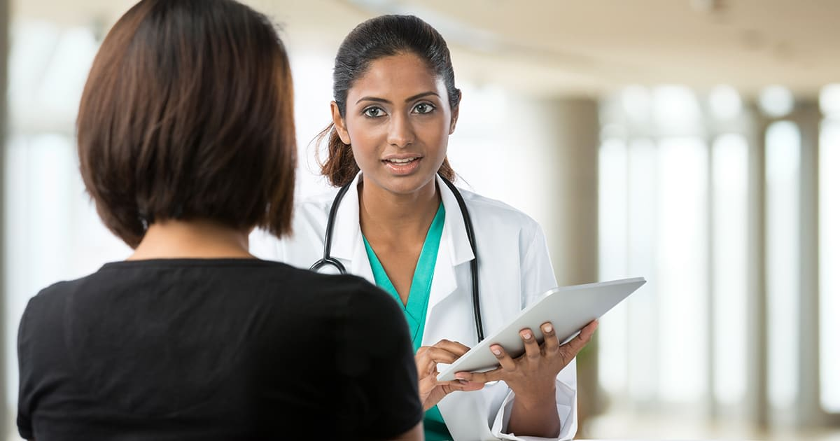 a female doctor speaking to a patient