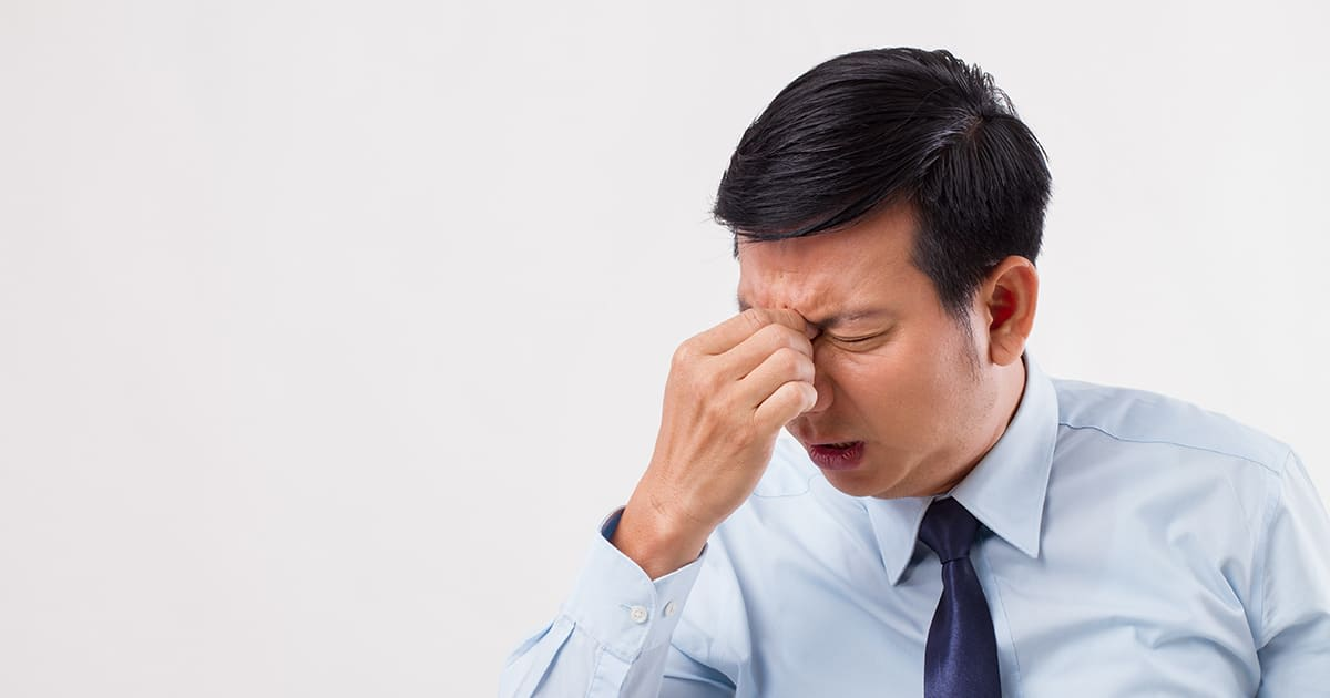 man with nose pain