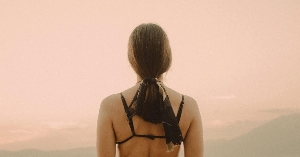 woman in a bra back facing camera