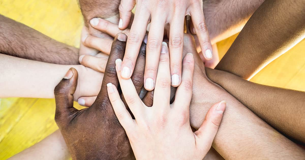 a group of multiethnic friends' hands
