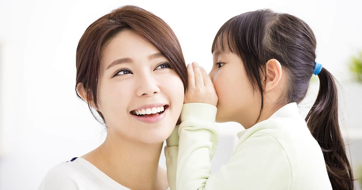 daughter whispering to mum