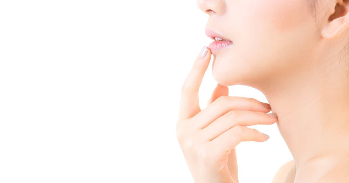 asian woman touching lips