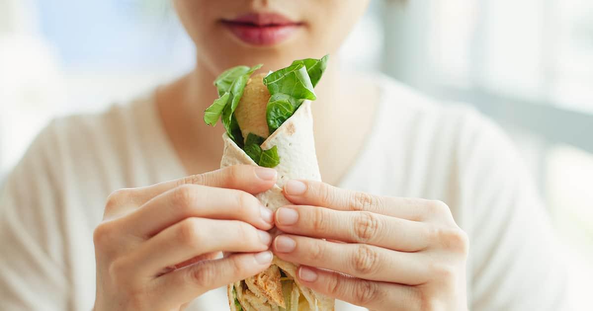 asian woman eating food
