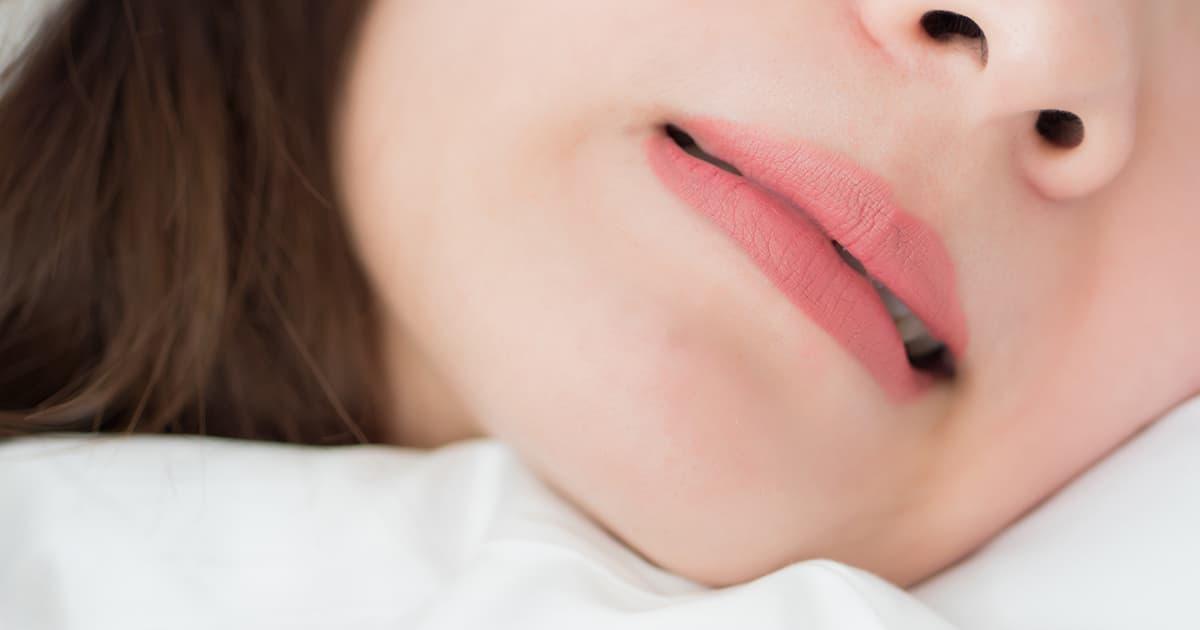 asian woman biting mouth