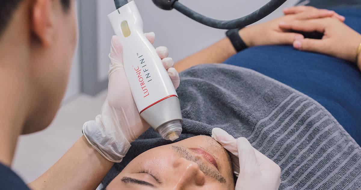 male patient receiving microneedling procedure