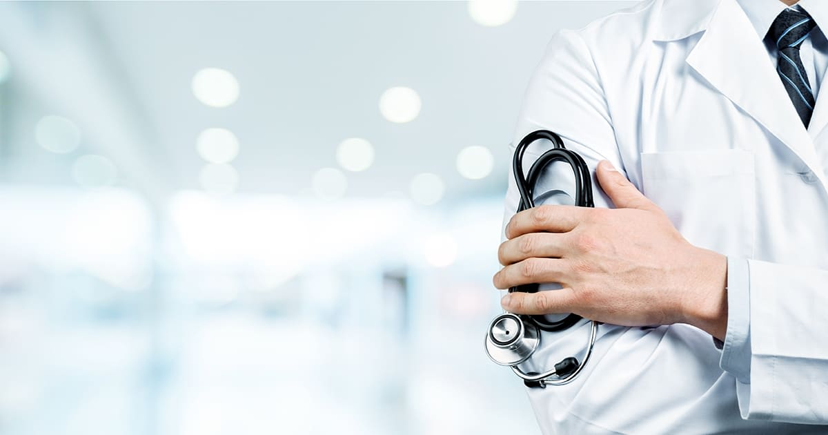 closeup on doctor holding stethoscope