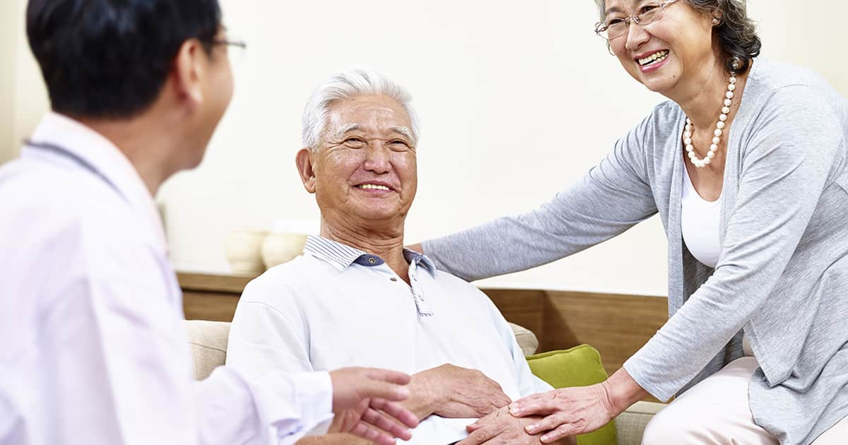 asian elderly men under care of doctor and wife