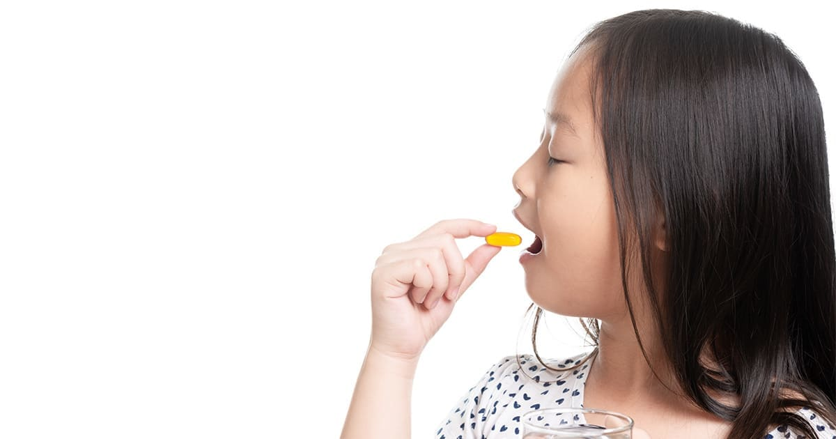 young-girl-taking-food-supplements