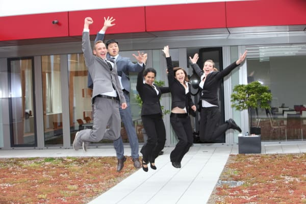 Triumphant business team cheering and celebrating