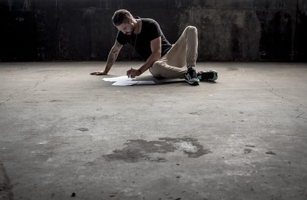 Man Writing Floor