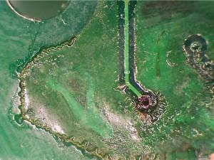 Dark areas on the copper are delaminated