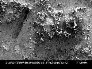 Micrograph of corrosion on oscillator housing