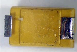 Mounting terminals under plastic encapsulation