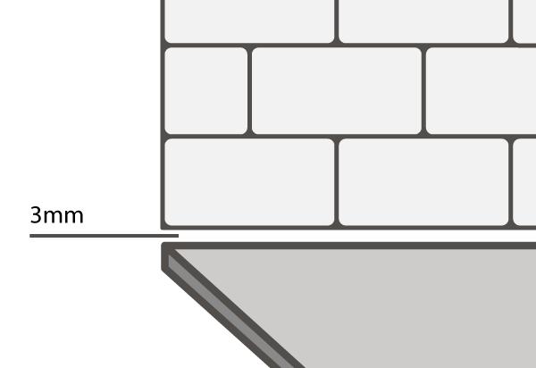 Ein kleiner Spalt von mindestens 3mm ist ratsam, wenn Sie Fliesen über Ihrer FENIX NTM® Compact Arbeitsplatte anbringen möchten.