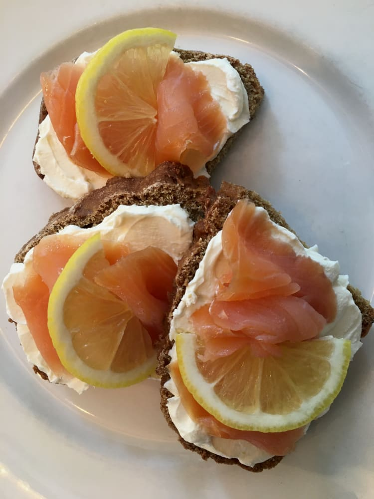 Rye and caraway soda bread served with smoked salmon and cream cheese arranged on a plate