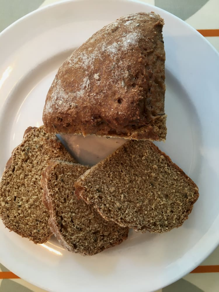Rye and Caraway Soda Bread cut into slices on plate