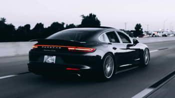 Black Porche 600 speeding down highway