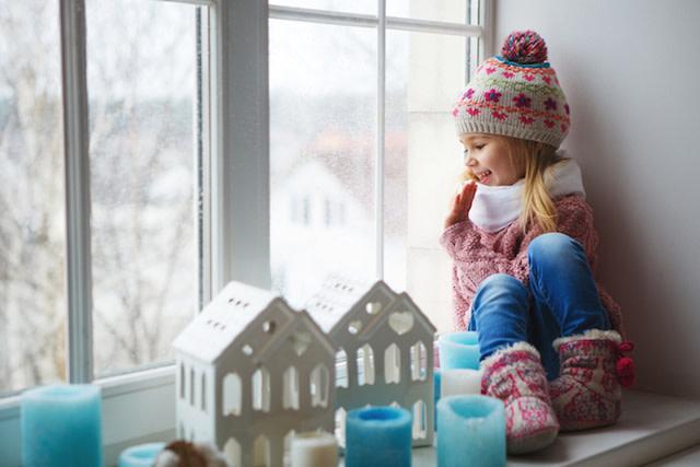 girl sitting by sealed window