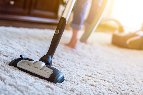 vacuum carpeting and dust
