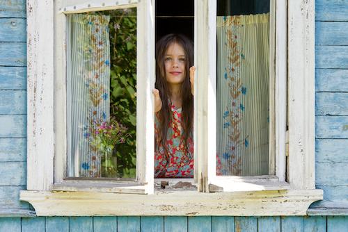 girl opening window