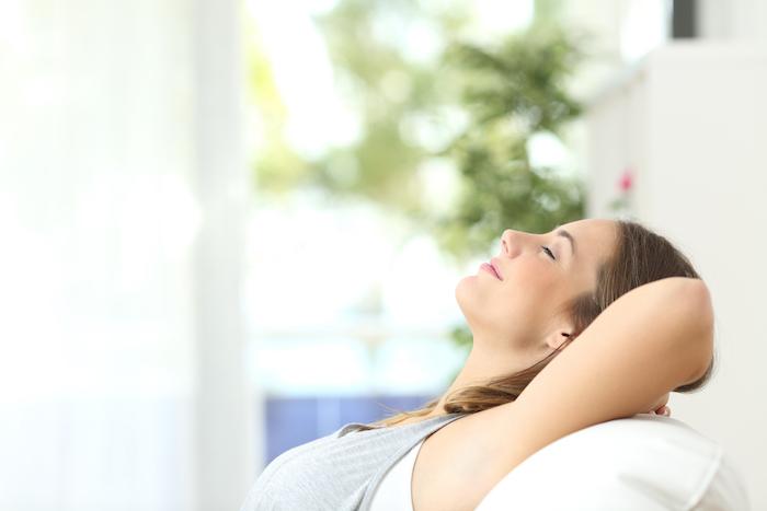 woman breathing clean, fresh air