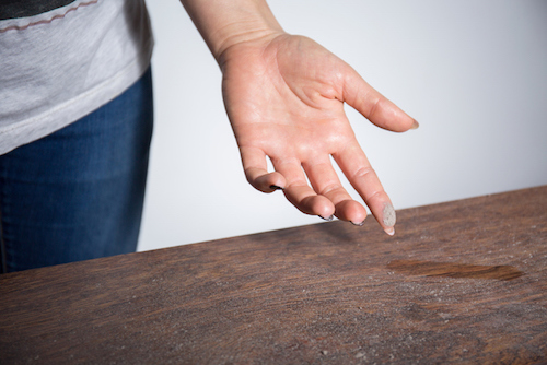 airborne dust falling on table