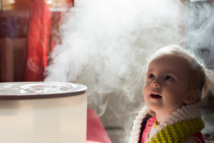child breathing air from humidifier