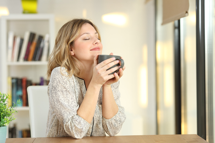 woman enjoying nice smell in home