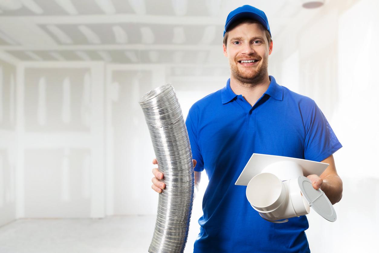 HVAC technician installing ventilation system