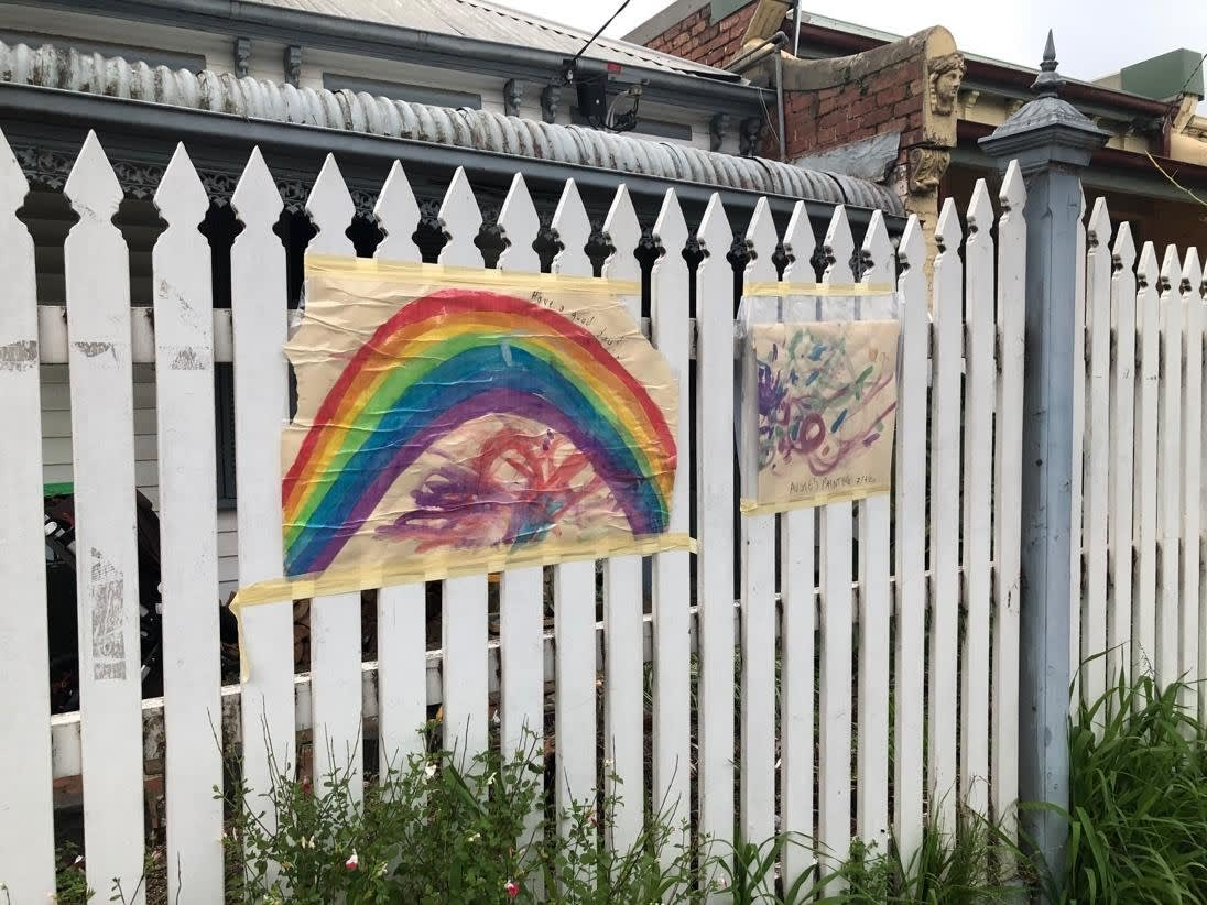 Rainbow hunt contribution on a dwelling fence. Image credit: [Julia Frecker]
