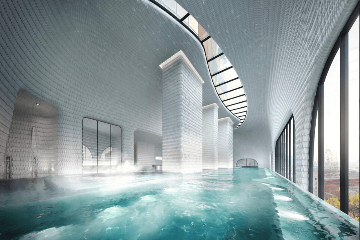 The Aspire heated infinity pool with city views and curved sky light.
