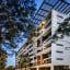 Quest serviced apartment founder Paul Constantinou sells to Ascott