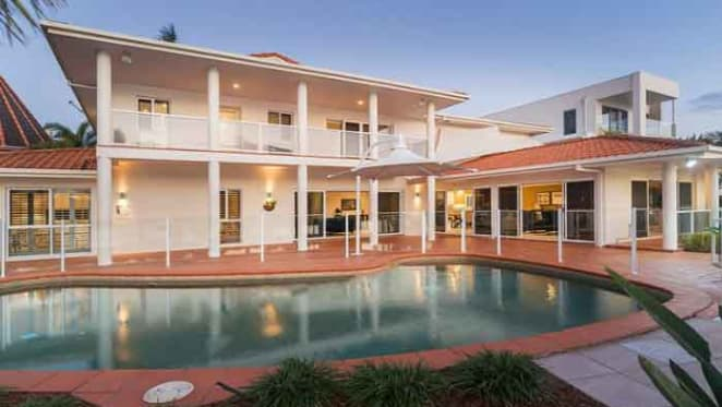 Gold Coast mayor Tom Tate sells at Paradise Waters