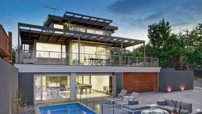Collingwood's Travis Cloke lists Kew home