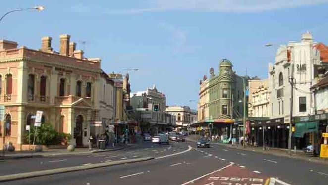 Greater Western Sydney Giants midfielder Rhys Palmer sells in Newtown
