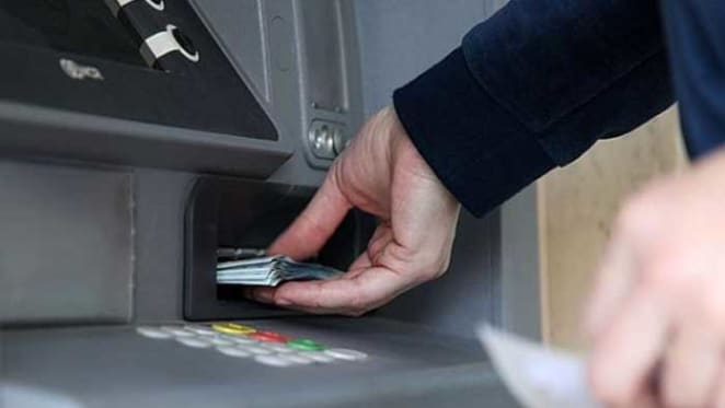 The ATM celebrates 50 years but we're using it less