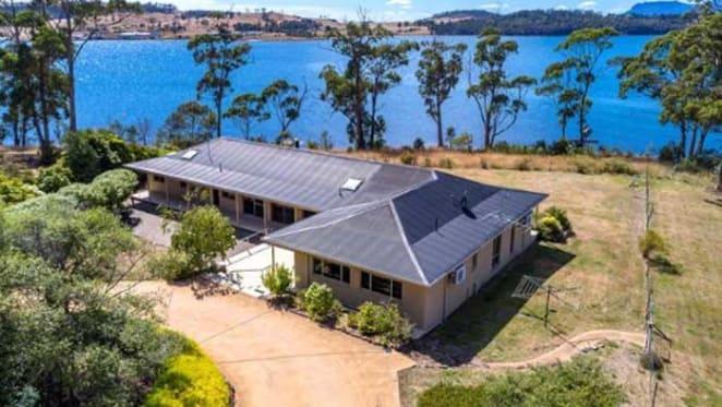 Contemporary Tasmanian beach house listed at Opossum Bay