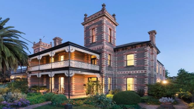 Coburg mansion, built as a mirror-image of next door, listed for sale