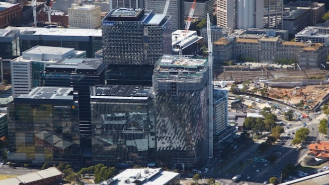 Multiplex tops out final commercial office tower at Collins Square