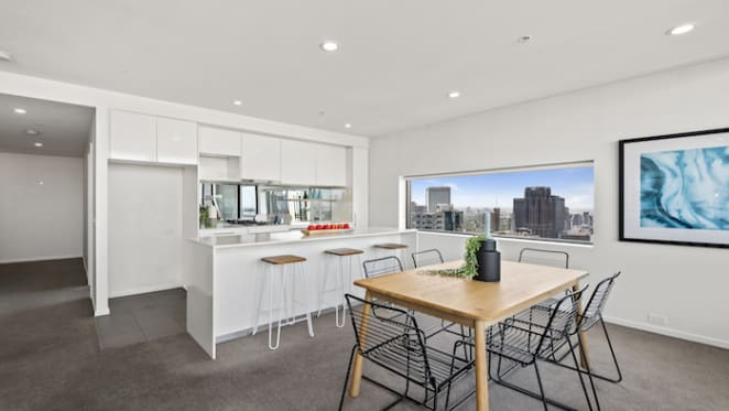 In-room auction nets $4.11 million for inner city Melbourne apartments