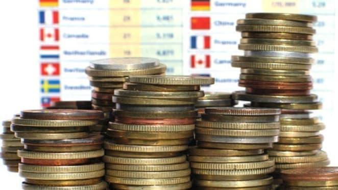 ANZ six month profit down, lifts some interest rates