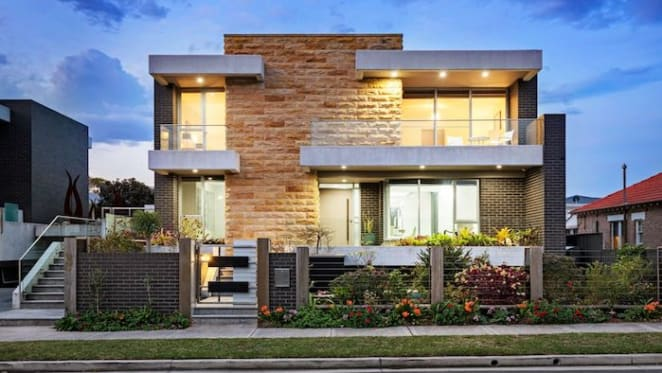 Sandringham trophy home with eight-car garage listed